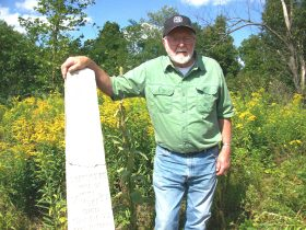 Ray Mosher with grave stone for our Great, Great grandmother, wife of Aaron Mosher, killed in Civil War while with the New York Volunteers